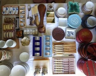 Lots of Japanese/Asian type serving plates, bowls, dishes.  Lots are new in the box.