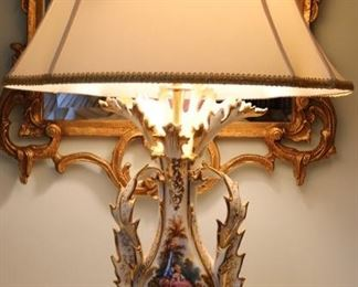 Pair of porcelain and figural bronze lamps