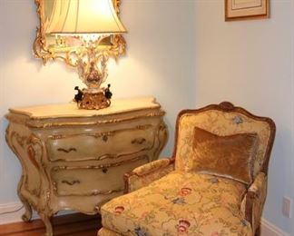 Custom upholstered lounge chair, pair of antique Italian giltwood and gesso marble-topped bombe commode(s)), gilt rococo mirror