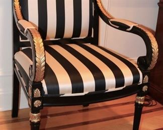 Custom upholstered, ebonized and carved gilt dining chairs