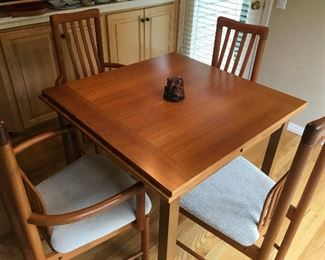 Danish mid-century modern teak dining table (in like-new condition) with teak Benny Linden chairs