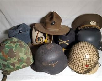 Militaria Helmets including German WWII US Camouflage, Russian Cap and more