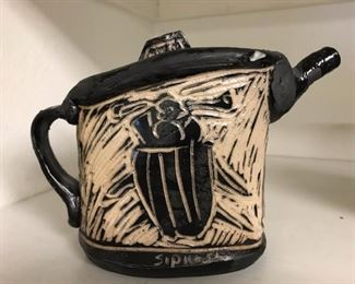 Local artist Dennis Sipiorski (teaches at SLU) teapot.  There are also cups