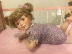 Beautiful Baby Doll, Porcelain with pink baby bed, others dolls and wood cradles too