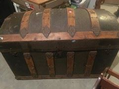 Old trunk with leather and metal patina embossments