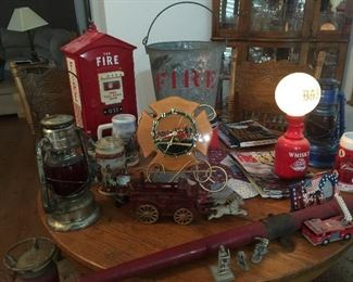 Fire call box with phone, OLD fire bucket, Cast Iron horse drawn hose wagon, Beer Steins, Vintage Fire Magazines. Vintage Clock
