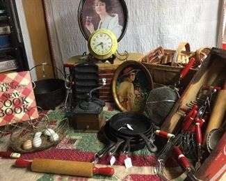 Red kitchen utensils Many cookbooks, Old Coca Cola products, picnic baskets Ceramic yellow kitchen clock runs