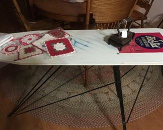 Advertising ironing board with a few linens