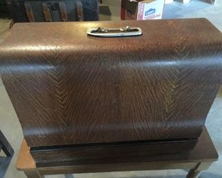 Beautiful Walnut cabinet with Sewing Machine and we have several old sewing baskets with great items, vintage in each one