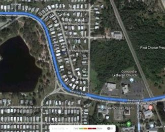 Turn onto Barefoot Bay Blvd from US1 and follow it past the recreation center.