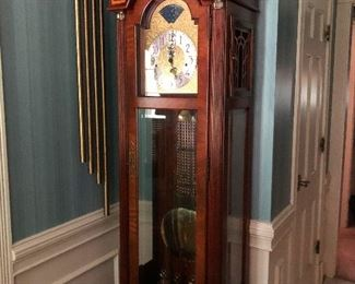 big grandfather clock with chimes so huge they had to be hung separately