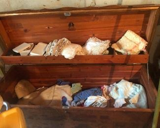 cedar chest full of doilies and lace and such