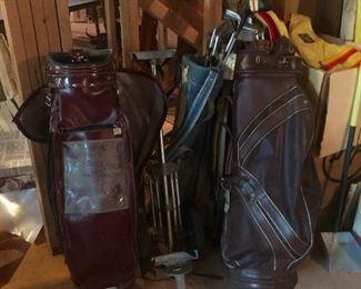 a bunch of golf clubs