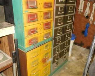 Several  metal tool cabinets stocked with bolts, nuts, etc.