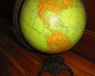 Antique globe on cast iron stand