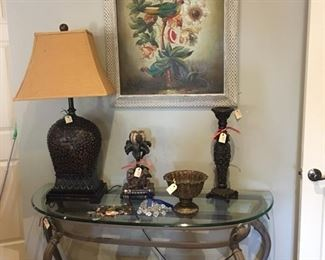 Pretty glass top console table, lamp, candlesticks, and floral painting