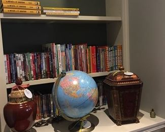 Lots of books, globe, and decorative jars