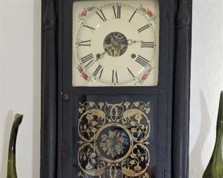 Many clocks throughout this luxury home. Black framed wooden clock.
