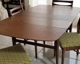 Beautiful Vintage Mid-Century Modern dining set. Has 3 leaves. Goes from a small table to a very large table for entertaining.