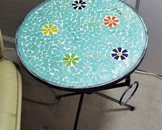 Mosaic table in turquoise and black. Can be used indoors or outdoors.