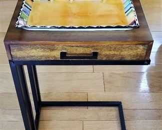 C table fits over the sofa or chair. Unusual because this one has a drawer where many of them don't.