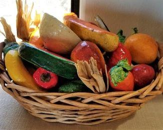 Ceramic fruit in a basket.