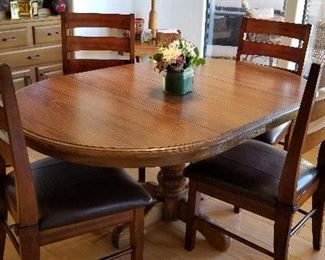 Solid wood oval kitchen/dining table and chairs.