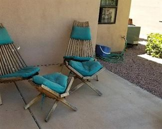Vintage outdoor chairs and matching footstools. You don't see these everyday.