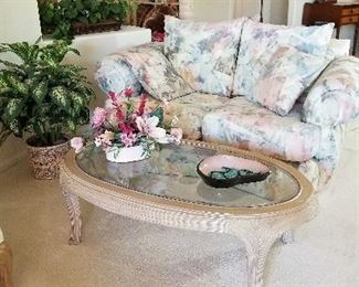 Great neutral oval coffee table with glass top and nice size loveseat.