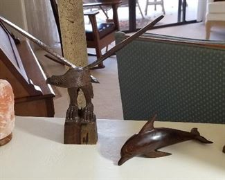 Wooden eagle and dolphins.