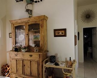 Look at that fabulous Native American Eagle feathered piece above the Antique hutch from the 1840's..