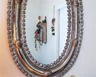 Metal silver oval mirror.