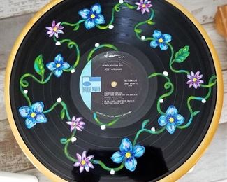 Handpainted art on vinyl records by local Arizona artist Isabela Rosalyn Olivares.