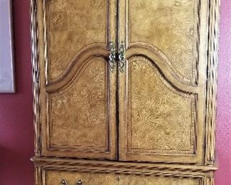 Beautiful Armoire matching the 4 poster bed great for TV or Storage.