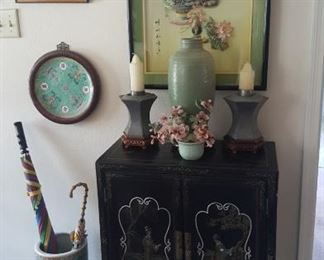 2 DOOR BLACK ORIENTAL CHEST....CELEDON VASE....LARGE SHELL PICTURE...UMBRELLA STAND...FRAMED PLATE...PAINTED TILE...ANTIQUE PAIR of CHINESE PEWTER CANDLE HOLDERS