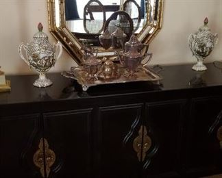Beautiful buffet with silver plate tea set and faux bamboo mirror