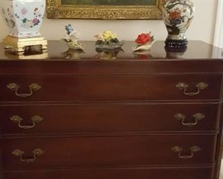 Nice mahogany four drawer chest and Asian inspired lamp