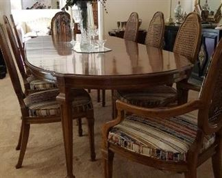 Gorgeous dining table with eight cane back chairs