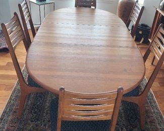 Dyrlund Teak Dining Table and 6 Mid Century Teak Dining chairs