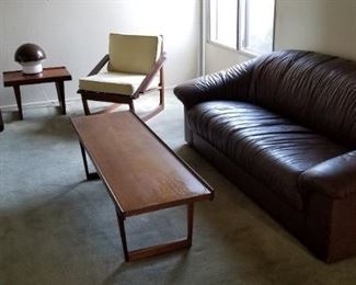 Peter Lovig Nielsen Coffee Table $800 Peter Lovig Nielsen End Table $350 Juul Kristensen Teak Chair $500 Brown leather sofa $100 Vintage dark brown chair $50