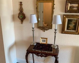 Rosewood table Georgian mirror Oil paintings and silver platted candle lamps