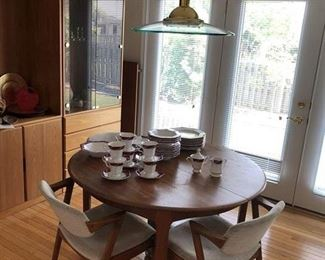 Mid Century Teak Table w/3 leaves and numerous chairs which need some TLC !