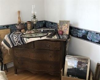 Antique chest of drawers (need TLC), Very Cool black and white framed photos, Some Indian art/pottery...