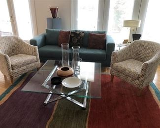 Club Chairs, Sleek Modern Sofa, Large Area Rug and Modern Glass and Chrome Table