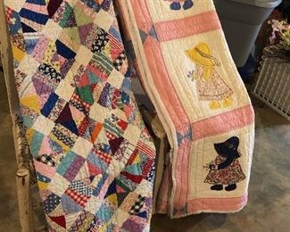 Selection of many antique and vintage quilts