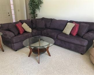 Purple Sectional Couch and Wood/Glass Coffee Table and End Table