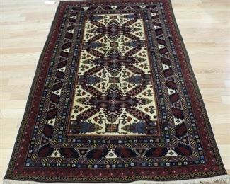 A Vintage And Finely Hand Woven Kazak Style Carpet