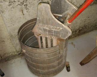 Vintage mop bucket on rollers.