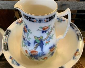 Stunning early Pitcher and Bowl set featuring colorful Bird Design.   Stagecoach Antiques is Offering 50% or more of ALL Inventory and Shelving units in the brick and mortar shop--July 26-28, 10-5 each day--see you in the shop!