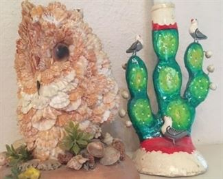 Owl sculpture made from sea shells, and one of two vintage cactus candlesticks from Mexico